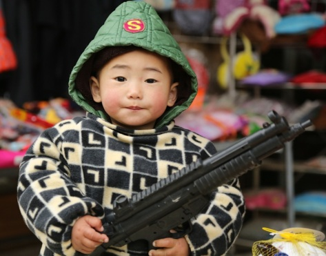 Kid with gun, Guizhou