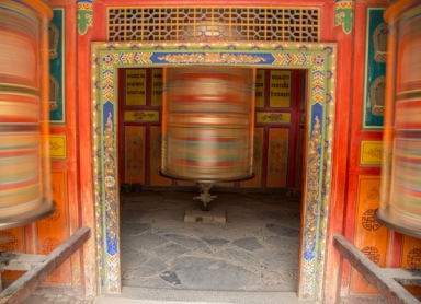 Spinning prayer wheels on the evening kora, Labrang Monastery, Xiahe, Gansu