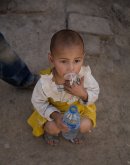 Little girl with a shaven head, Yarkand