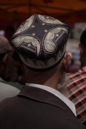 A snake oil seller's audience, Kashgar
