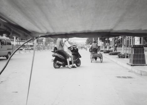 Street scene from a rickshaw, Qufu