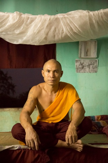 Monk and bed, Myawaddy