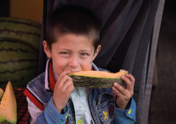 Boy with melon.
