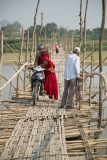 Monks cross a temporary bridge near Bhamo in northern Myanmar. The bridge is swept away each year by the monsoon; villagers rebuild it in a matter of days once the rains have stopped.